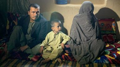 Image shows Shamsullah, a child and Goljuma