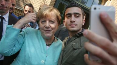 Angela Merkel poses for a selfie with a Syrian refugee in Berlin, 10 September 2015
