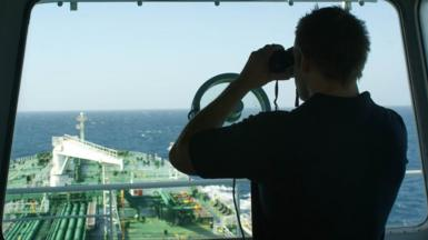 Keeping watch: a British security guard on the bridge of a merchant tanker off the coast of Oman during the height of the Somali piracy threat. Photo: Frank Gardner