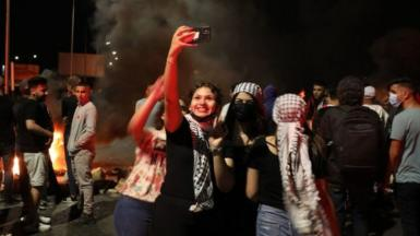 Palestinian protesters take a selfie, May 2021