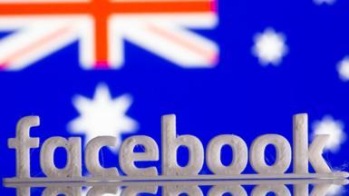 Facebook logo over an Australian flag
