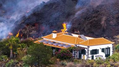 Home spared from the lava flow after a volcanic eruption on the Canary Island of La Palma, Spain