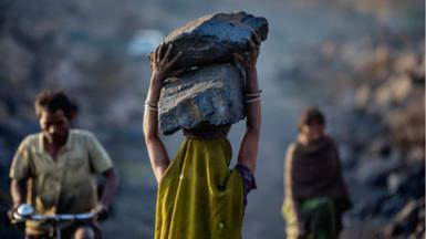 woman carries coal in Jharkhand, India