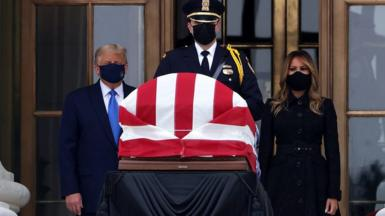 US President Donald Trump and Melania Trump behind Ruth Bader Ginsburg's casket