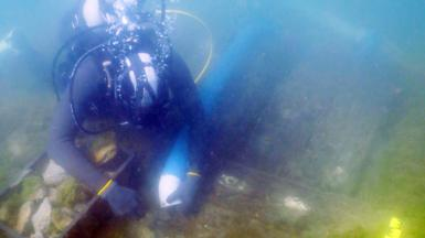 Diver during expedition exploring the vessel