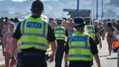 Photo of police officers patrolling Bournemouth beach