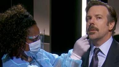 Jason Sudeikis, right, pretending to have a coronavirus test while presenting the Emmy for outstanding comedy series during the 72nd annual Primetime Emmy Awards ceremony in Los Angeles