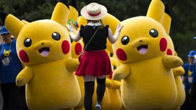 Performers dressed as Pikachu, a character from Pokemon series game titles, march during the Pikachu Outbreak event hosted by The Pokemon Co. on August 10, 2018 in Yokohama, Kanagawa, Japan.