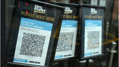 Track and trace QR codes are displayed outside a pub, in Manchester, north west England in October, 2020
