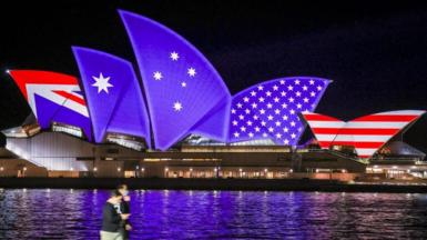 The American and Australian flags projected onto the sails of the Sydney Opera House on 1 September 2021 to mark the 70th anniversary of the Anzus security alliance