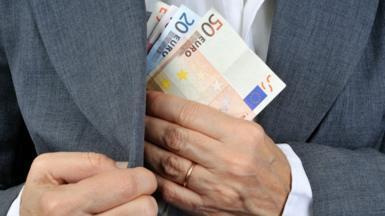 Man putting euros in pocket