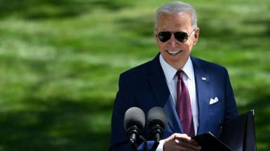 US President Joe Biden arrives to deliver remarks on the Covid-19 response outside the White House in Washington, DC, on 27 April