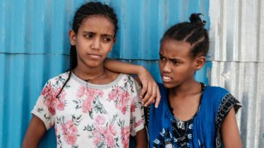 Girls displaced by violence in Ethiopia's Tigray region wait for aid in Mekelle - June 2021