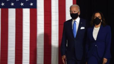 Democratic presidential nominee Joe Biden and vice presidential running mate, Kamala Harris, arrive to conduct their first press conference