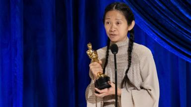 Chloe Zhao with her Oscar for best director