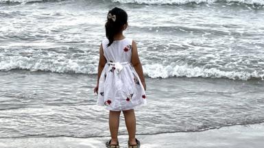 Girl on a beach in Iran