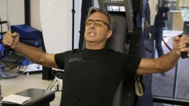 Man pushing weights in the gym