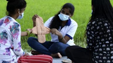 Muni Gupta teaching girls to make homemade reusable sanitary pads