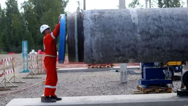A worker at the construction site of a section of the Nord Stream 2 natural gas pipeline near Kingisepp, Leningrad Region in 2019