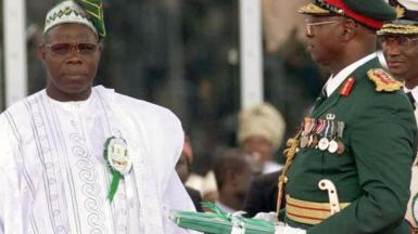 Olusegun Obasanjo standing alongside Abdulsallam Abubakar