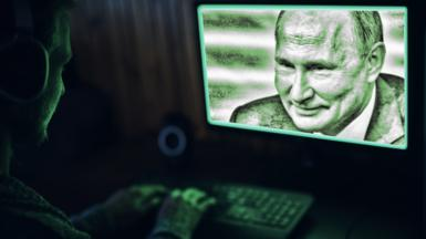 Hacker looks at picture of Putin