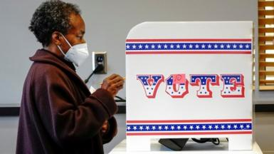 Ruby Lenora casts her in-person vote on her 73rd birthday at a polling site in Milwaukee, US October 20, 2020