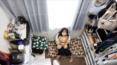 Woman sitting in tiny Tokyo flat