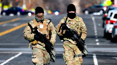 Members of the US National Guard patrol a street in Washington DC - 17 January 2021