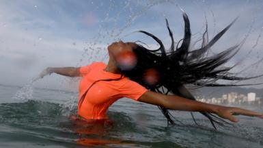 Ballet dancer Anoushka Zoe James dances in the water at the Ipanema beach in Rio de Janeiro, Brazil, 29 October 2020