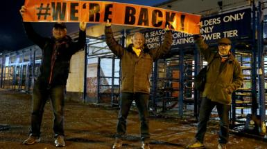 Luton Town fans pose with a banner prior to the Sky Bet Championship match at Kenilworth Road, Luton