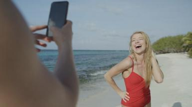 Woman on beach having photo taken