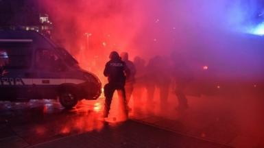 Police clash with protesters in Milan