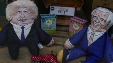 Dog toys on sale in a Cornish shop featuring caricatures of Boris Johnson and Joe Biden