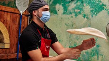 Pizza restaurant worker in Lisbon