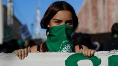 A demonstrator wearing a green handkerchief takes part during a demonstration in favour of decriminalization of abortion on 28 September