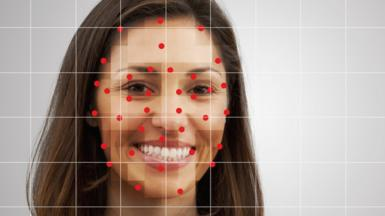 A woman being checked by a facial recognition system