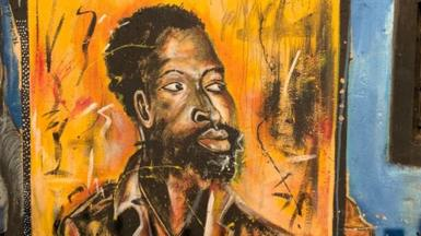 Portrait mural of Job Maseko