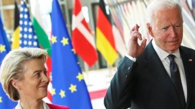 U.S. President Joe Biden crosses his fingers next to European Commission President Ursula von der Leyen as they attend the EU-US summit, in Brussels, Belgium June 15, 2021