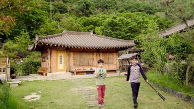 Boys playing sport in South Korean village