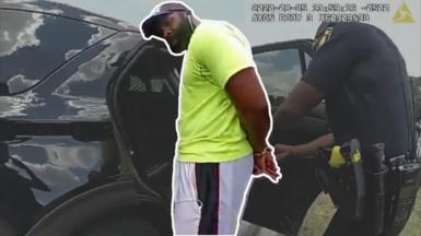 Jogger Mathias Ometu being arrested