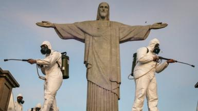 Military personnel disinfect the area surrounding the statue of Christ the Redeemer