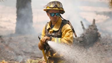 Fireman tackling wildfire