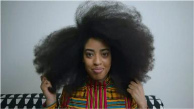 Simone Williams sees her hair, which measures nearly 1.5m in circumference, as a symbol of pride