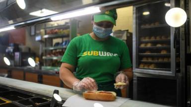 Subway employee makes sandwich