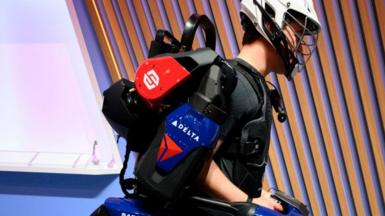 A man wearing a Sarcos Robotics exoskeleton