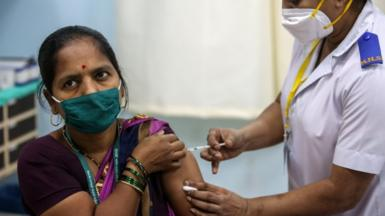 A woman gets a vaccines at Rajawadi Hospital in Mumbai, India