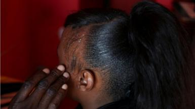 A customer has her hair done by a stylist at a saloon in Soweto, South Africa, September 11, 2020. Picture taken September 11, 2020.