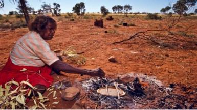 Woman baking in Australian outback