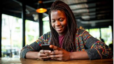 A young woman using a phone
