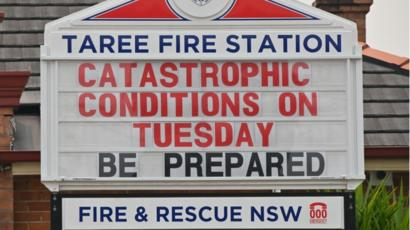 Australian wildfires. Fire. A sign warning people to be prepared for catastrophic fire conditions in Taree, NSW